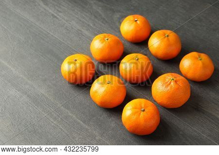 Flat Lay With Tasty Mandarins On Textured Wooden Table
