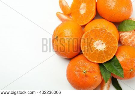 Mandarin Pile With Leaves On White Background