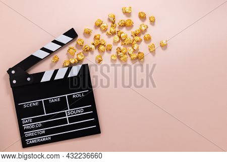 Popcorn And Clapperboard. Cinema Background.top View With Copy Space. Flat Lay