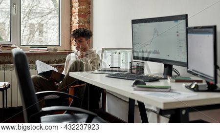 Millennial Gen Z African American Male Trader Read Book Study Distant At Home, Get Passive Income Tr