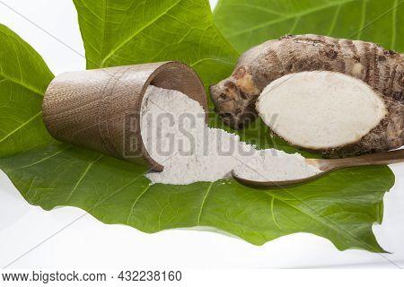 Taro Root Of Colocasia Esculenta And Organic Taro Flour In A Bowl