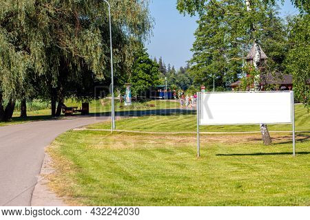 Empty Advertising Billboard In The Park Next To The Walkway, Outdoor Advertising Concept, Mockup