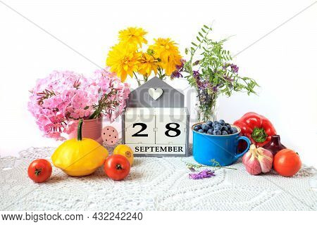 Calendar For September 28 : The Name Of The Month In English, Cubes With The Number 28, Ripe Vegetab