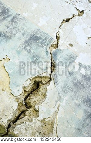 Big Crack On Blue Wall Of Old Building, Abstract Image Of Diagonal Crack, Detail. Consequences Of Ea