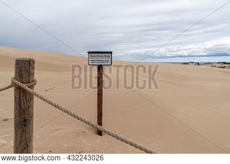 Fence Post And Rope With A A No Trespassing Sign In The Pristine Sand Dunes Nature Reserve Of Slowin