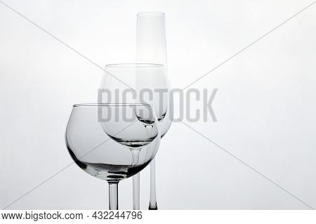 Three Empty Wineglasses Diffrent Shape  On Whete Background With Copy Space