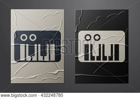 White Music Synthesizer Icon Isolated On Crumpled Paper Background. Electronic Piano. Paper Art Styl