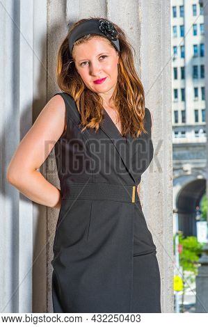 Wearing A Black Sleeveless Trench Coat Dress And A Hair Band, Hands Putting On The Back, A Young Pre
