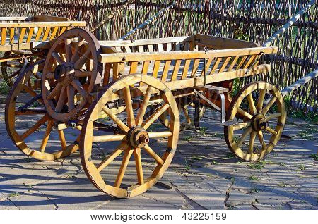 Old wooden cartage cart near the fence
