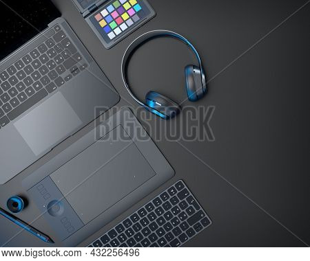 Top View Of Designer Workspace And Gear Like Laptop, Tablet, Keyboard And Phone On Black Table Backg