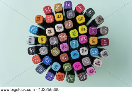 A Set Of Colored Markers, Multi-colored Markers, A Top View On A Turquoise Background, The Concept O