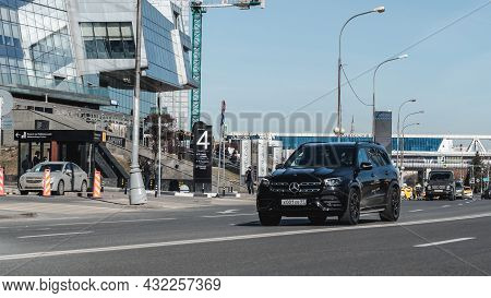 Black Mercedes-benz Gls 450 4matic X167 On The City Road. Premium Suv Fast Driving On Road In The Ci
