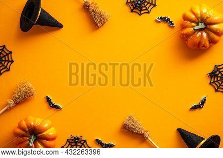 Halloween Greeting Card Mockup. Halloween Decorations, Pumpkins, Witches Hats, Bats On Orange Backgr
