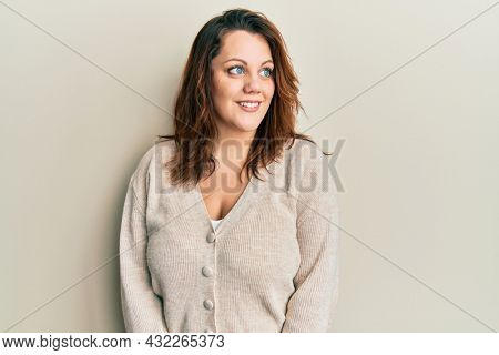 Young caucasian woman wearing casual clothes smiling looking to the side and staring away thinking.
