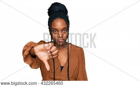 Young african american woman wearing casual clothes looking unhappy and angry showing rejection and negative with thumbs down gesture. bad expression.