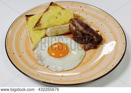 English Break Fast Concept, Fried Egg Sunny Side Up, Cheese Toast, Crispy Bacon And Sausage