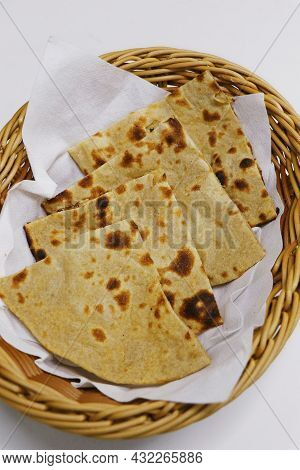 Tandoori Naan Bread Or Roti In A Basket, Indian Clay Oven Baked Bread