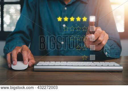 Businessman Finger Pointing Smiley Face Emoticon On Virtual Touch Screen.good Feedback Rating And Po