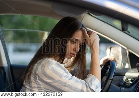 Sad Young Woman Suffer From Stress Inside Car. Upset Unhappy Female Driver Sit On Front Seat Pensive