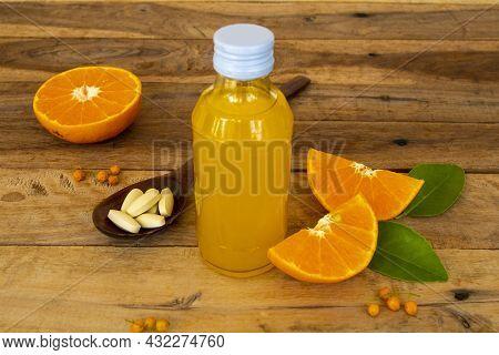 Vitamin C Pills Dietary Supplement With Orange Vitamin C Water For Health Care Arrangement Flat Lay