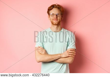 Portrait Of Satisfied Caucasian Man With Red Hair And Beard, Cross Arms On Chest And Smiling With Sm