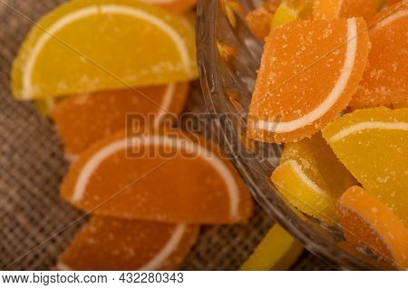 Multi-colored Shaped Marmalade Lemon Slices In A Glass Vase, Close-up, Selective Focus