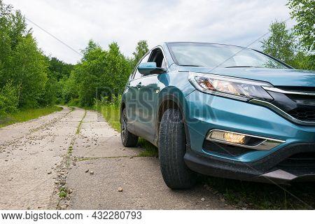 Likitsary, Transcarpathia, Ukraine - Jul 02, 2020: Suv On The Side Of Concrete Road Through Forest.