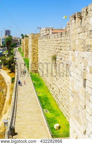 Jerusalem, Israel - August 30, 2021: Scene Of The Old City Walls Park Promenade, With Visitors, In J