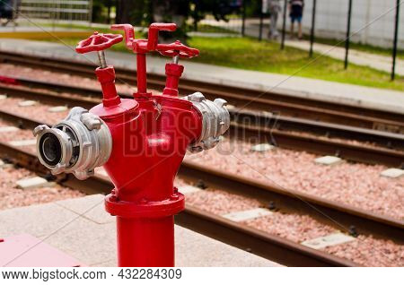 Top View Of The Single Red Fire Hydrant, Which Standing On The Pavement Near Rails. Kyiv Children's