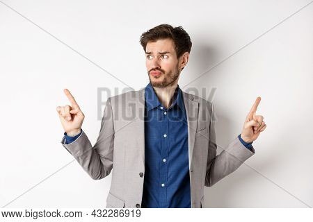 Complicated Businessman Pointing Two Ways, Troubled To Choose, Looking Aside And Thinking, Making De