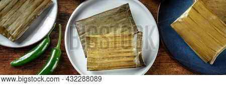 Tamal Panorama. Traditional Dish Of Mexican Cuisine, Various Stuffings Wrapped In Green Leaves. Hisp