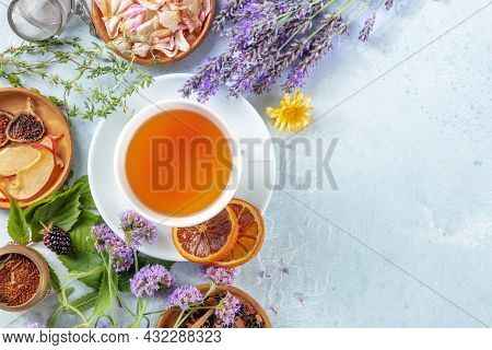 Tea, Top Shot With A Place For Text. Herbs, Flowers And Fruit Around A Cup Of Healthy Organic Hot Dr