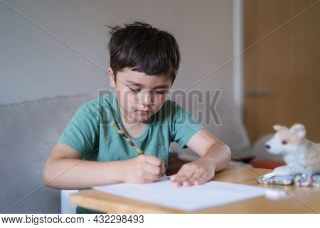 Schoolboy Using Pencil Drawing On White Paper Sheet, Young Kid Doing School Homework, Happy Mixed Ra