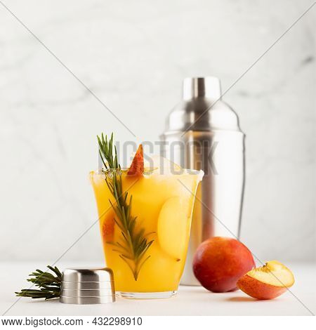 Bright Fruit Summer Beverage Mixed With Ripe Peach, Ice, Green Rosemary Twig, Sugar Rim, Ingredients
