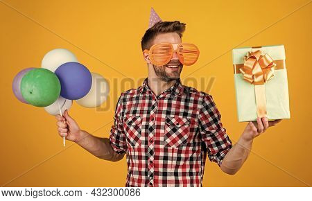 Happy Birthday To You. Male Holiday Celebration. Bearded Guy With Party Balloons And Gift Box. Unsha