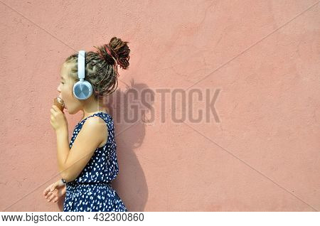 Little Braided Girl Listening To Music Wearing Headphones And Eating Icecream. Summer Vibes.