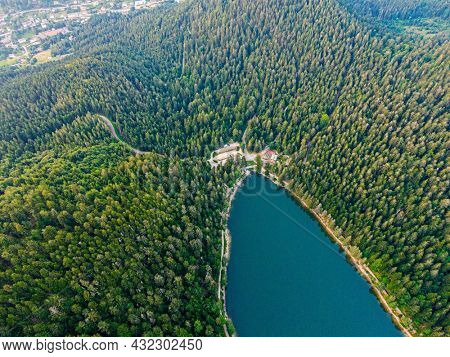 Aerial view of the Lac des corbeaux surrounded by forest, Voges, La Bresse, Lake Crows