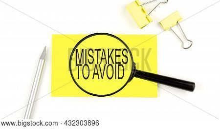 Mistakes To Avoid Text On The Sticker Through Magnifier. View From Above. Business