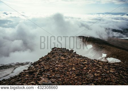Atmospheric Scenery On Top Of Mountain Ridge With Snow Above Thick Low Clouds. Minimalist View From