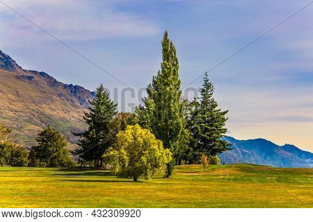 The surroundings of the city Queenstown. Mountains and meadows. Travel to New Zealand, South Island. The concept of active, ecological, automotive and photo tourism