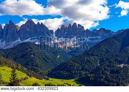 Dolomites on a sunny autumn day.  The world's most beautiful village in the Dolomites: Santa Maddalena. Europe, Val de Funes.