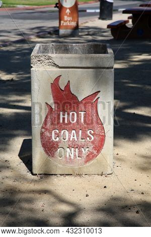 Hot Coals Only. Cement Hot Coals Only Trash Can. A Cement trash can in a park for Hot Coals from the Barbecue.