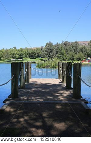 Boat Dock. A Fishing Dock. A observation dock. A small public dock on a man made lake.