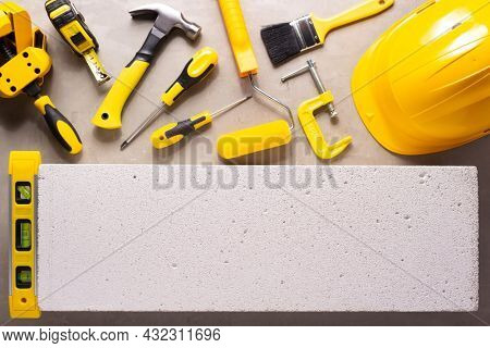 Aerated concrete  block background. and construction tools. Lightweight concrete with tool