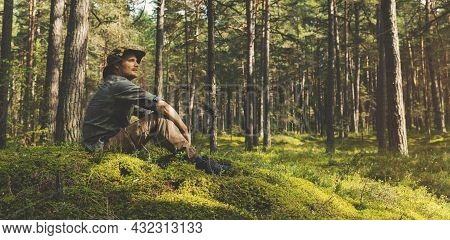 Forest Ranger Or Forester Sitting On The Hill And Watching The Territory. Copy Space