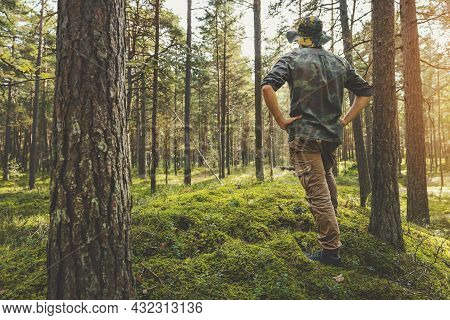 Forest Development And Sustainable Forestry. Ranger Monitoring The Woodland Ecosystem