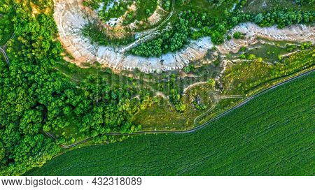 Aerial drone view - Beautiful summer landscape old chalk quarry. Bird view over nature landscape with old chalk quarry. Green  summer landscape from the top view.