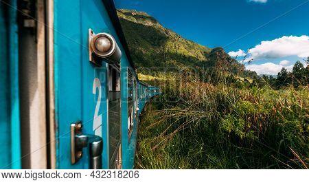 Travel By Train, Panorama. Road Trip. Blue Sri Lankan Train Goes Through Jungles, Trees, Wood, Mount
