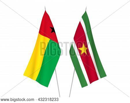 National Fabric Flags Of Republic Of Guinea Bissau And Republic Of Suriname Isolated On White Backgr