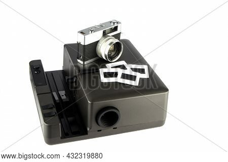 Old Film Camera With Slide Projector And Slides Isolated On White